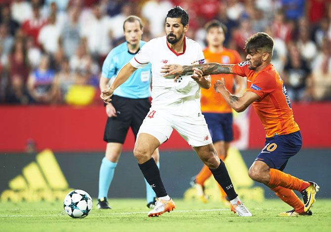 Sevilla FC's Manuel Agudo 'Nolito' (left) competes for the ball with an Istanbul Basaksehi's player during the UEFA Champions League Play-Offs second leg match at Estadio Ramon Sanchez Pizjuan in Seville, Spain, on Tuesday