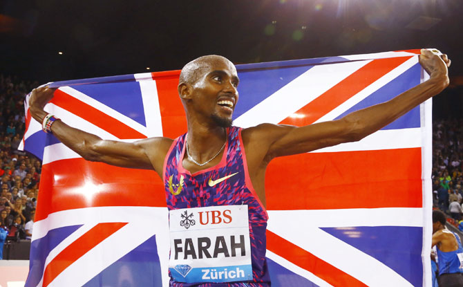 Britain's Mo Farah celebrates winning the gold medal in the men's 5000 metres run at the IAAF Athletics Diamond League in Letzigrund Stadium, Zurich on Thursday