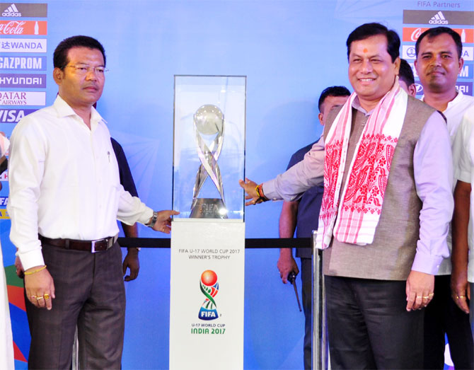 Assam Chief Minister Sarbananda Sonowal unveils the official winner's trophy of the FIFA U-17 World Cup India 2017 on Saturday