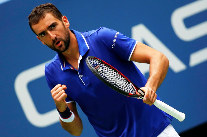 Croatia's Marin Cilic celebrates celebrates a point during his win against USA's Tennys Sandgren in their first round match