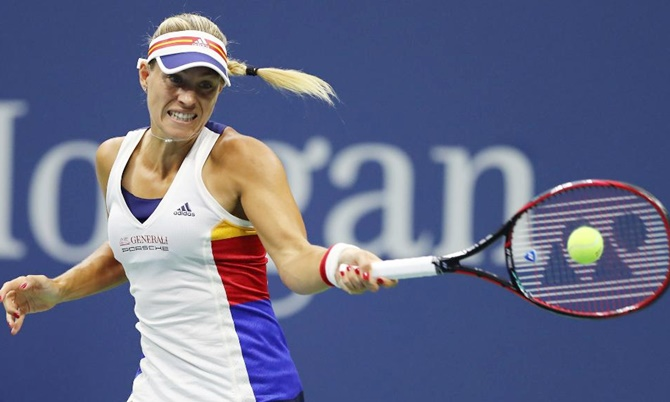 Defending champion Angelique Kerber revealed she was having trouble with her elbow during the US Open opening round loss to Japan's Naoi Osaka on Tuesday