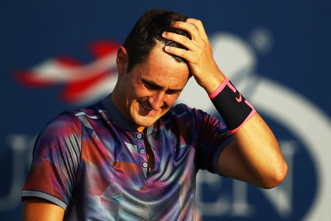 Australia's Bernard Tomic reacts during his first round loss to Luxembourg's Gilles Muller on Day One of the 2017 US Open at the USTA Billie Jean King National Tennis Center in the Flushing neighborhood of the Queens borough of New York City on Monday