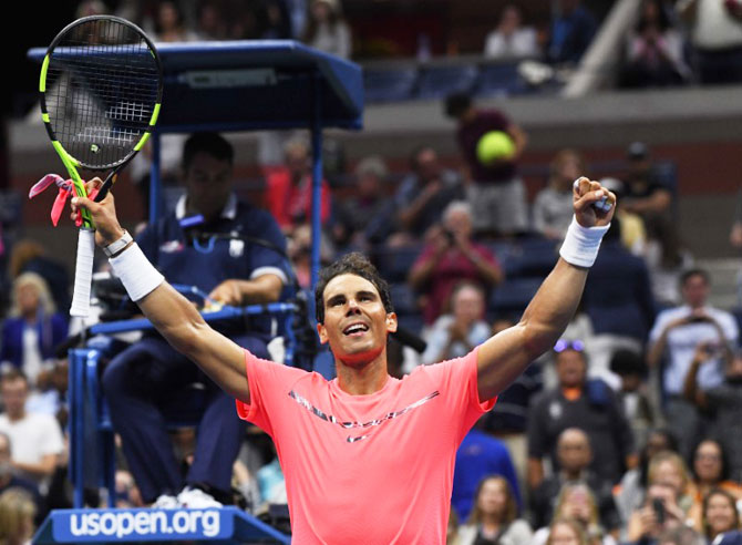 Spain's Rafael Nadal celebrates after beating Serbia's Dusan Lajovic in Ashe Stadium at the USTA Billie Jean King National Tennis Center on Tuesday
