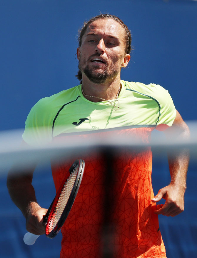 Ukraine's Alexandr Dolgopolov reacts during his US Open first round Men's match against Germany's Jan-Lennard Struff on Day 3 of the 2017 US Open at the USTA Billie Jean King National Tennis Center in the Flushing neighborhood of the Queens borough of New York City in New York on Wednesday