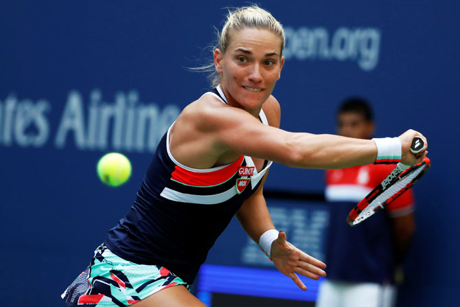 Hungary's Timea Babos in action against Maria Sharapova
