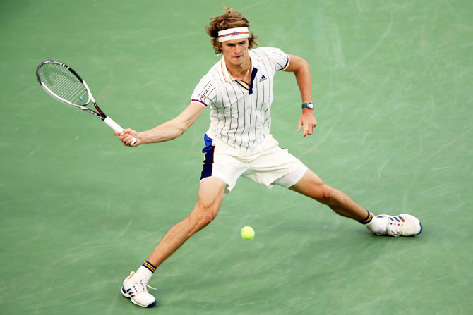 Germany's Alexander Zverev returns a shot against Croatia's Borna Coric during their second round at the USTA Billie Jean King National Tennis Center