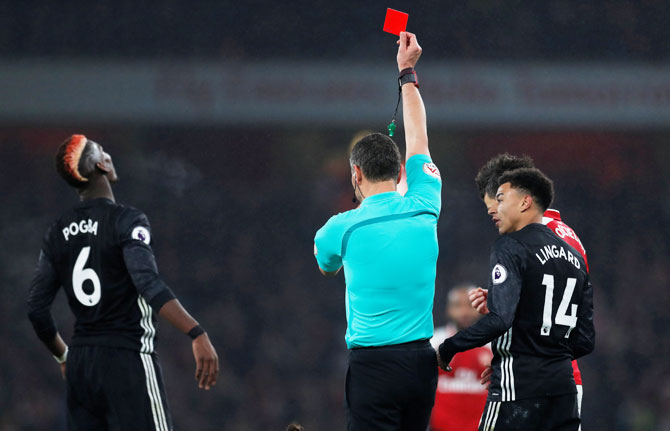Manchester United's Paul Pogba is given the marching orders by referee Andre Marriner