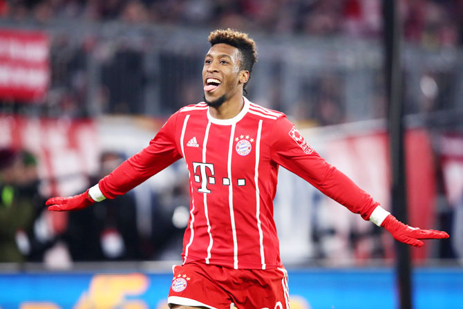 Bayern Munich's Kingsley Coman celebrates scoring their second goal against Hannover 96 at Allianz Arena, in Munich on Saturday