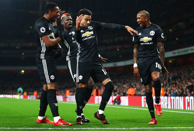 PHOTOS: 10-man Manchester Utd stun Arsenal at Emirates