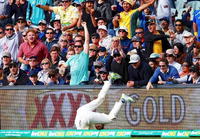 The crowd reacts as England's Dawid Malan fails to stop a boundary during the first day of the second Ashes cricket Test match at Adelaide Oval in Adelaide on Saturday