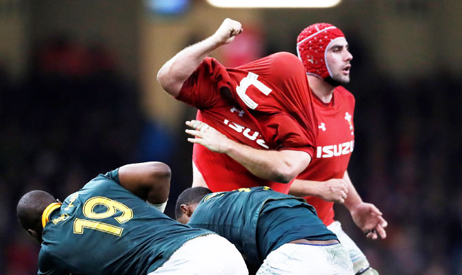 Wales' Scott Andrews reacts after his shirt is pulled over his head during the Rugby Union,  Autumn Internationals match against South Africa at Principality Stadium, Cardiff, on Saturday