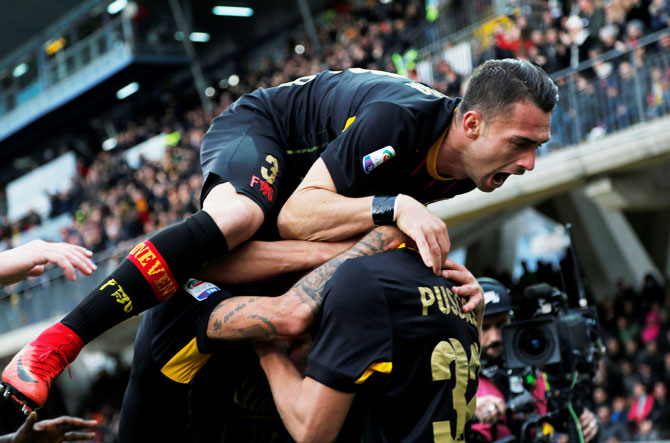 Benevento's George Puscas celebrates with teammates after scoring their first goal against AC Milan during their Serie A match on Sunday