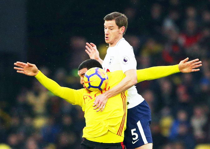 Tottenham's Jan Vertonghen and Watford's Troy Deeney vie for possession during their English Premier League match at Hertfordshire in Watford on Saturday