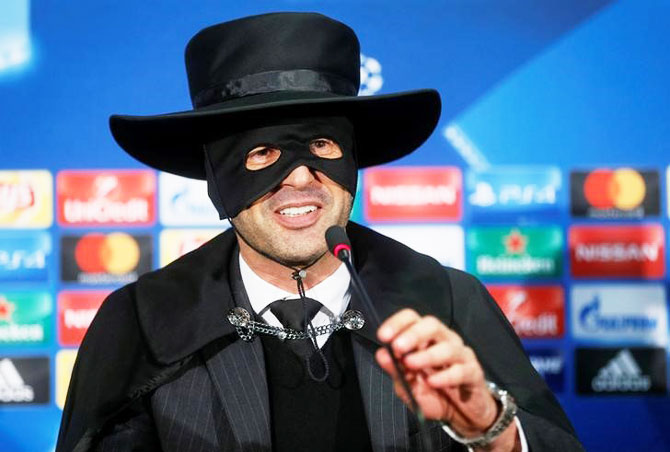 Shakhtar Donetsk's coach Paulo Fonseca, dressed as Zorro, attends a news conference after his club beat Manchester City during their Champions League match at Metalist Stadium, in Kharkiv, Ukraine on Wednesday