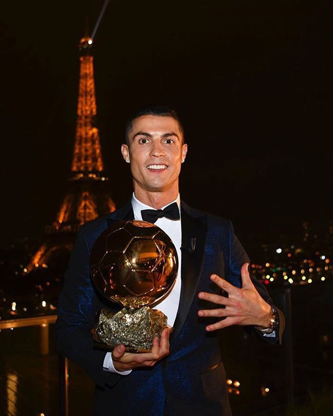 Cristiano Ronaldo poses with the Ballon d'Or award on Thursday