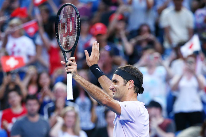 Switzerland's Roger Federer celebrates winning his 2018 Hopman Cup match against Japan's Yuichi Sugita at Perth Arena in Perth, Australia, on Sunday