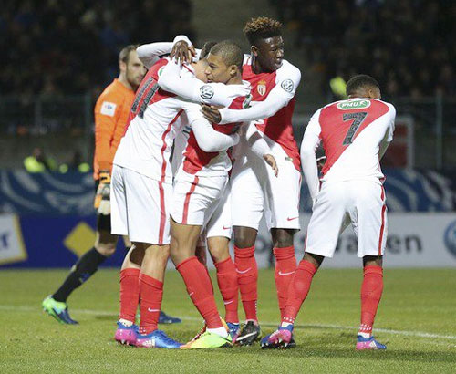 Monaco players celebrate a goal on Wednesday
