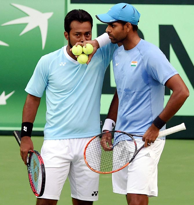 Rediff Sports - Cricket, Indian hockey, Tennis, Football, Chess, Golf - Tennis Roundup: Vardhan bags 2nd title, Paes loses