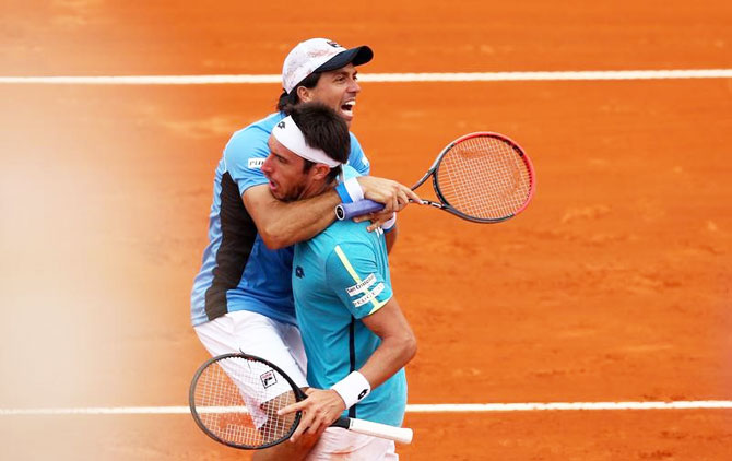 Argentina's Carlos Berlocq and Leonardo Mayer celebrate after winning their doubles match against Italy's Fabio Fognini and Simone Bolelli in the Davis Cup World Group First Round tie at Parque Sarmiento stadium in Buenos Aires, Argentina, on Saturday