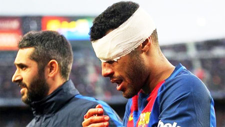 FC Barcelona's Rafinha has his face covered in bandage by the medical staff on Saturday