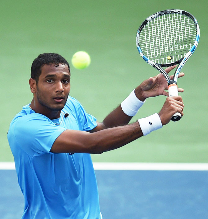 India's Ramkumar Ramanathan plays a return against New Zealand's Finn Tearney during their Davis cup tie in Pune on Sunday