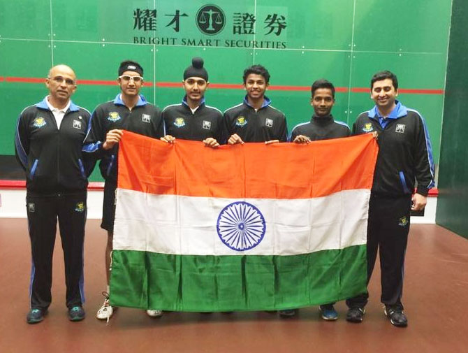 The gold medal-winning boys team hoist the flag at the Asian Junior Squash meet in Hong Kong on Sunday