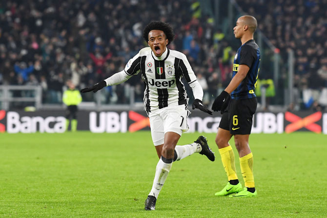 Juventus FC's Juan Cuadrado celebrates after scoring the opening goal against Inter Milan during the Serie A match between at Juventus Stadium in Turin, on Sunday