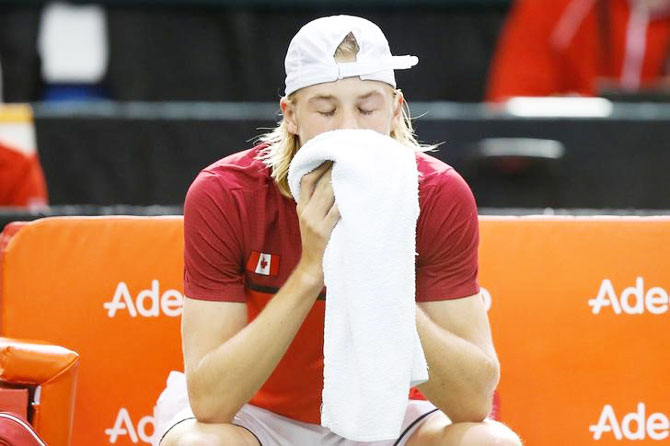 Canada's Denis Shapovalov reacts after the umpire was struck by a ball during his Davis Cup singles match against Britain's Kyle Edmund on Sunday