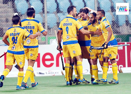 Punjab Warriors players celebrate a goal against Delhi Waveriders during their HIL match on Tuesday