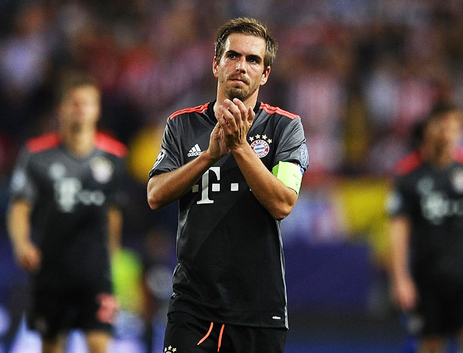 Bayern Munich's Philipp Lahm, who retired from internationals after Germany's World Cup victory in Brazil, came through Bayern's ranks before spending two seasons on loan at VfB Stuttgart between 2003-2005