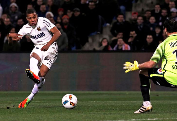 Monaco's Kylian Mbappe Lottin scores past Montpellier's goalkeeper Geoffrey Jourdren during their French Ligue 1 match at Mosson stadium, Montpellier, on Tuesday