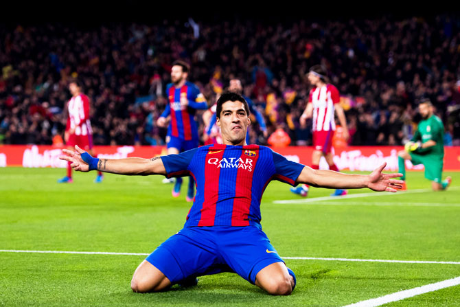 FC Barcelona's Luis Suarez celebrates after scoring the opening goal during their Copa del Rey semi-final second leg match against Atletico de Madrid at Camp Nou in Barcelona on Tuesday