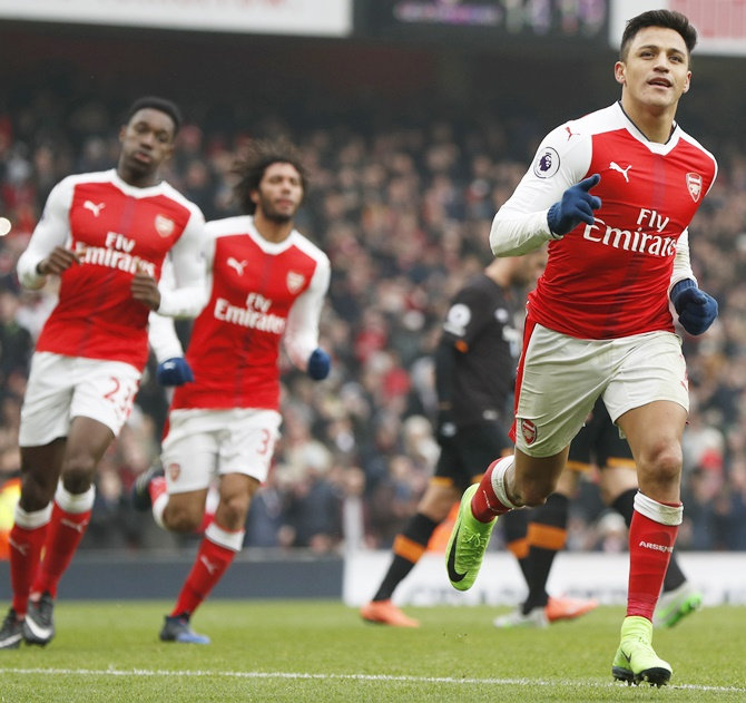 Arsenal's Alexis Sanchez, right, celebrates scoring
