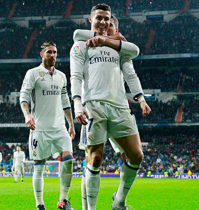 Rediff Sports - Cricket, Indian hockey, Tennis, Football, Chess, Golf - La Liga: Real back on top after Osasuna win