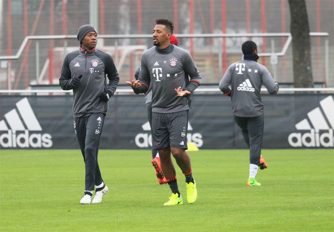 Bayern Munich's Jerome Boateng (right) and a teammate at a training session on Monday