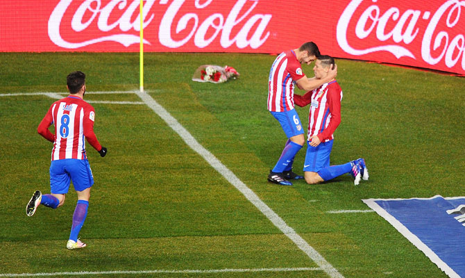 Atletico de Madrid's Fernando Torres celebrates with Koke after scoring his team's opening goal during their La Liga match against RC Celta de Vigo at Vicente Calderon Stadium in Madrid on Sunday