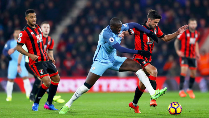 Manchester City's Yaya Toure battles for the ball with Bournemouth's Andrew Surman
