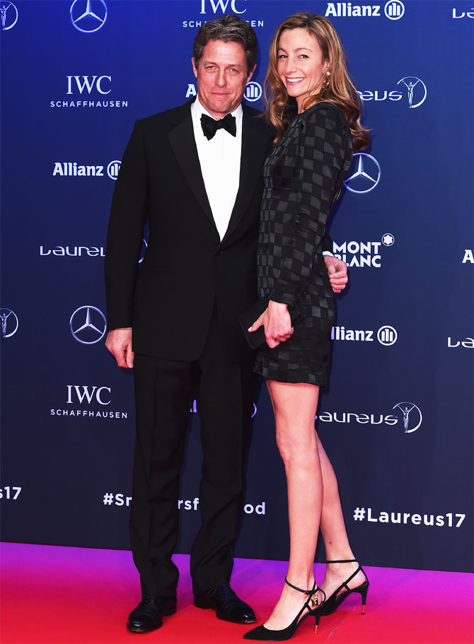 2017 Laureus World Sports Awards host Hugh Grant and a guest at the red carpet on Tuesday