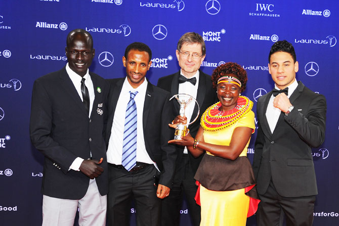 The Winners of the Laureus Sport for Good the Olympic Refugee team pose with their trophy and Laureus Academy Member Tegla Loroupe at the Winners Press Conference and Photocall at the Salle des Etoiles,Sporting Monte Carlo in Monaco on Tuesday