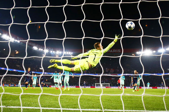 Barcelona keeper Marc-Andre ter Stegen goes airborne as he fails in his attempt to stop Angel Di Maria score his team's third goal