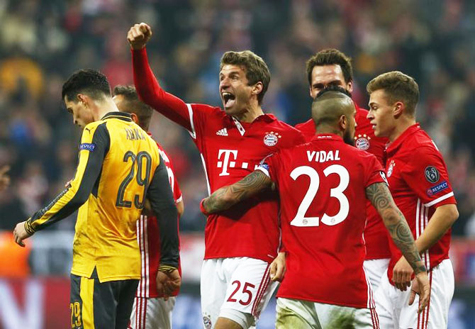 Bayern Munich's Thomas Muller celebrates scoring their fifth goal against Arsenal during their UEFA Champions League Round of 16 First Leg match at Allianz Arena in Munich on Wednesday