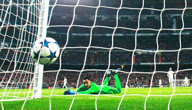 Goalkeeper Keylor Navas of Real Madrid dives in vain as Lorenzo Insigne of Napoli (not pictured) scores their first goal
