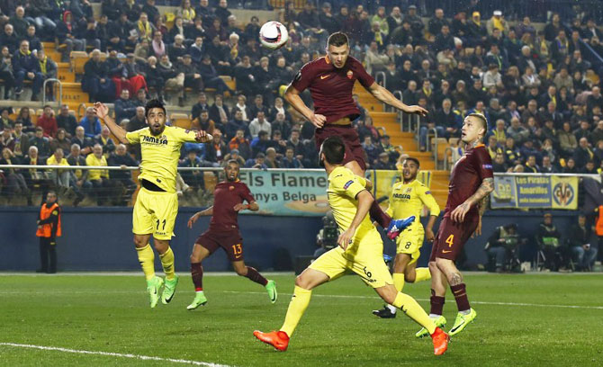 Roma's Edin Dzeko heads at goal during their UEFA Europa League Round of 32 First Leg match against Villareal at Estadio de la Ceramica, in Villarreal on Thursday