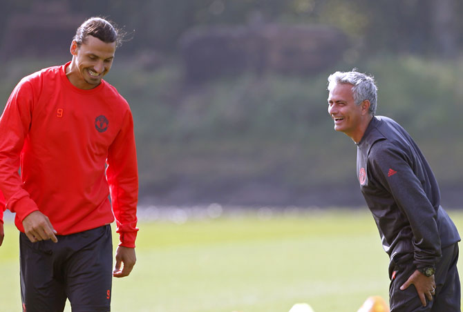Manchester United manager Jose Mourinho, right, speaks to Zlatan Ibrahimovic