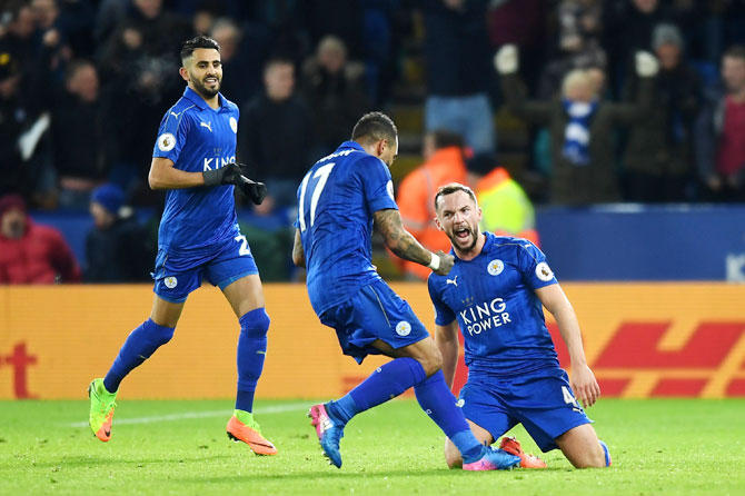 Leicester City's Daniel Drinkwater celebrates with teammates after scoring his side's second goal
