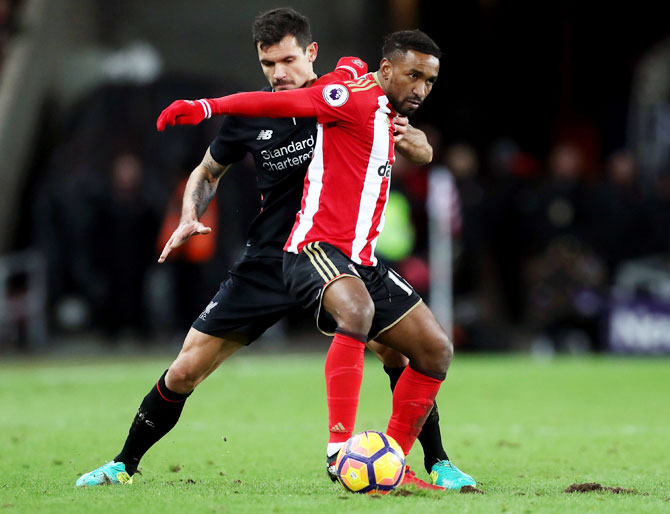 Liverpool's Dejan Lovren (left) and Sunderland's Jermain Defoe (right) battle for the ball during their Premier League match at Stadium of Light in Sunderland on Monday