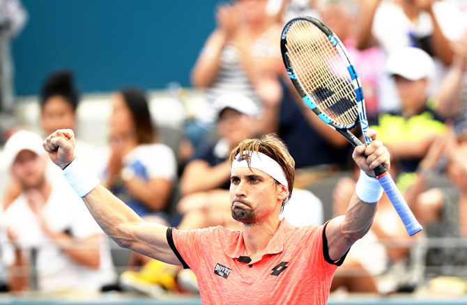 Spain's David Ferrer celebrates victory after his match against Australia's Bernard Tomic  on Day 2 of the 2017 Brisbane International at Pat Rafter Arena in Brisbane on Monday