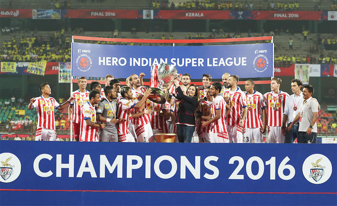 2016 ISL champions Atletico de Kolkata celebrate with ISL Chairperson Nita Ambani after defeating Chennaiyin FC on December 18