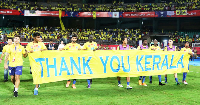 Kerala Blasters players hold up a banner after the semi-final. ISL was the most viewed televised sport event of the year in Kerala