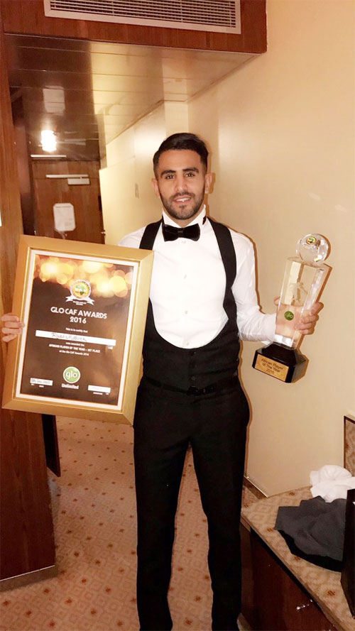 Leicester City's Algerian striker Riyad Mahrez shows off his African Player of the Year Award